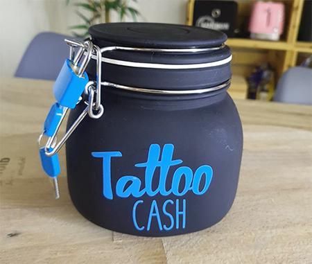 pot en verre pour argent tatouage